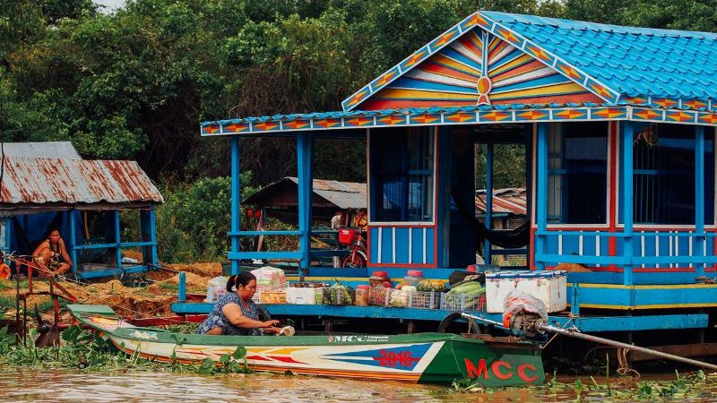 A colourful house and canoe in Cambodia