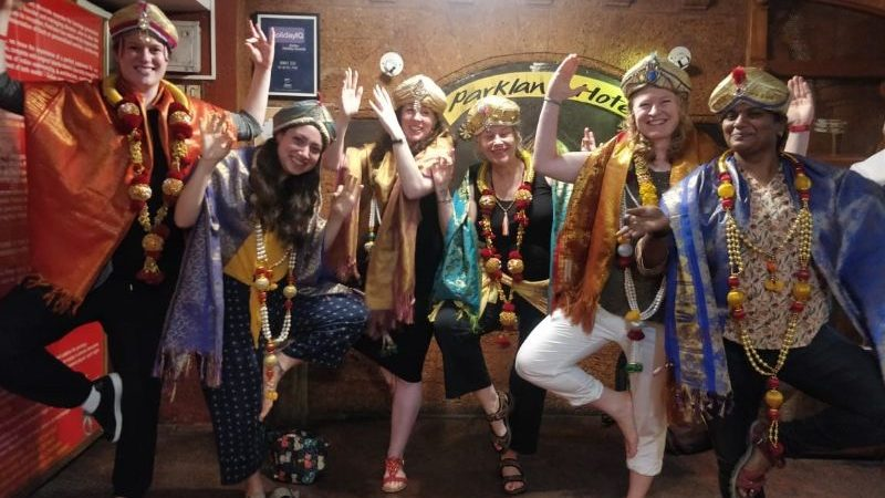 Travellers dressed up in Kathali costumes