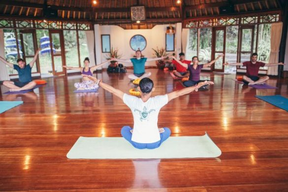 Group of travellers doing yoga