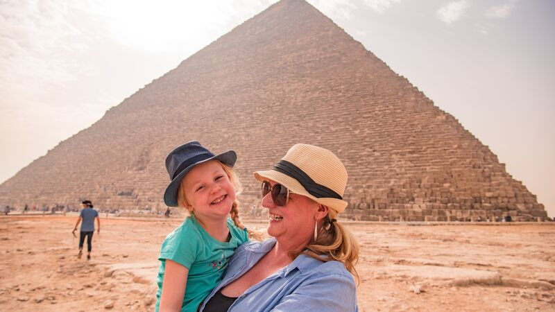 A mother and her daughter at the pyramids