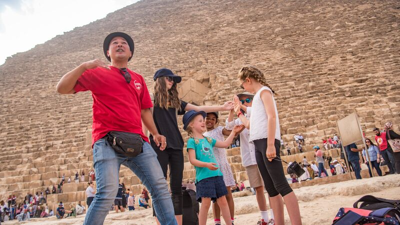 A tour leader and some kids at the pyramids in Egypt