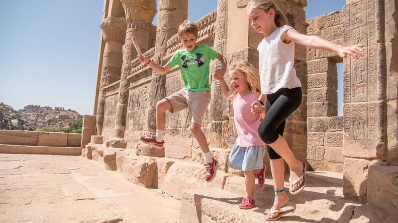 Three young children having fun in Egypt