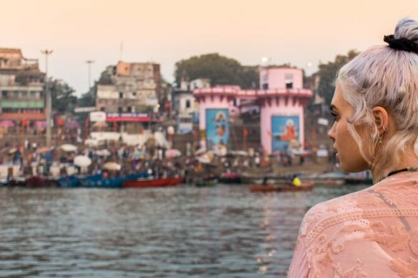 A young woman looks out over the Ganges in Varanasi