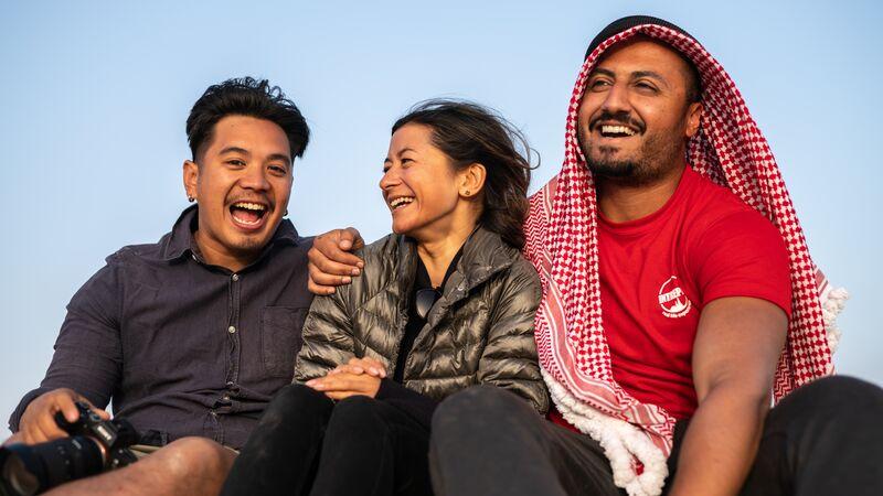 Three travellers in Wadi Rum, Jordan.