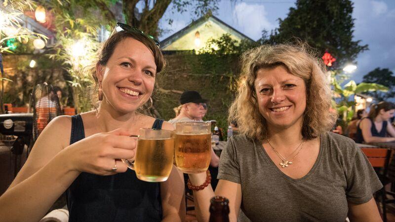 Two women enjoying a beer in Vietnam