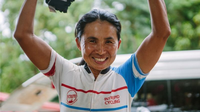 A woman wearing a cycling jersey in Cambodia