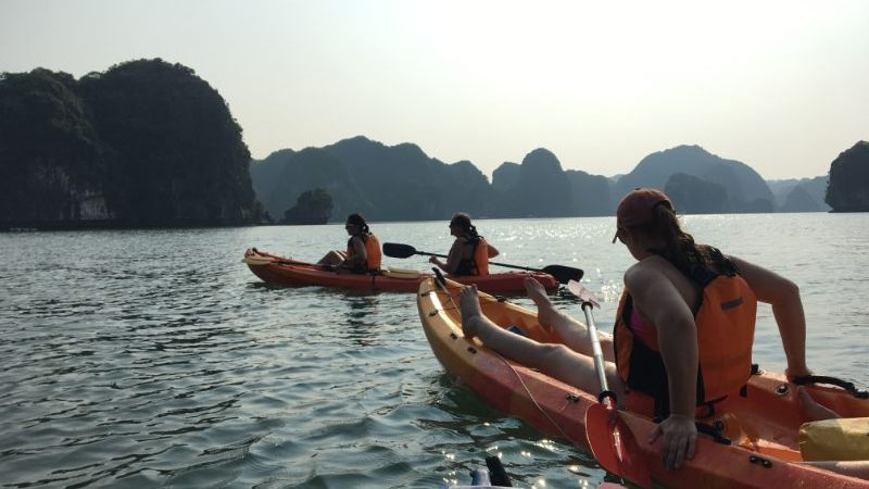 People sitting in kayaks in Halong Bay