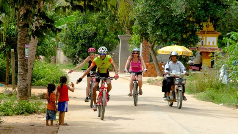A tour group cycling through Cambodia