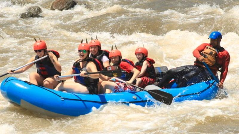 A group of people white-water rafting