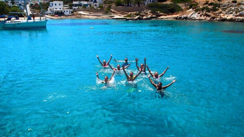 Swimmers in a beautiful cove in Greece