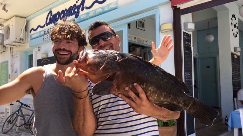 Two men holding a big fish in Greece