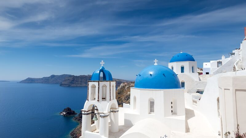 Blue-domed churches in Santorini in the Greek Islands