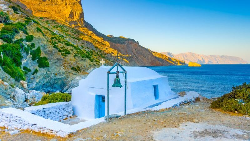 A small white church next to the sea in Amorgos, Greek Islands