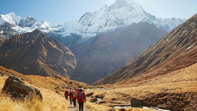 A group of porters walking into Annapurna Base Camp