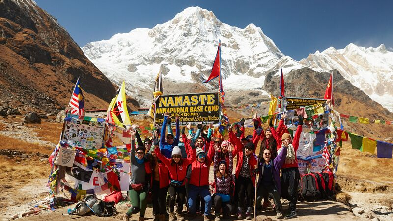 A group of trekkers and porters at Annapurna Base Camp, Nepal