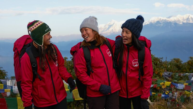 Three female porters at Poon Hill