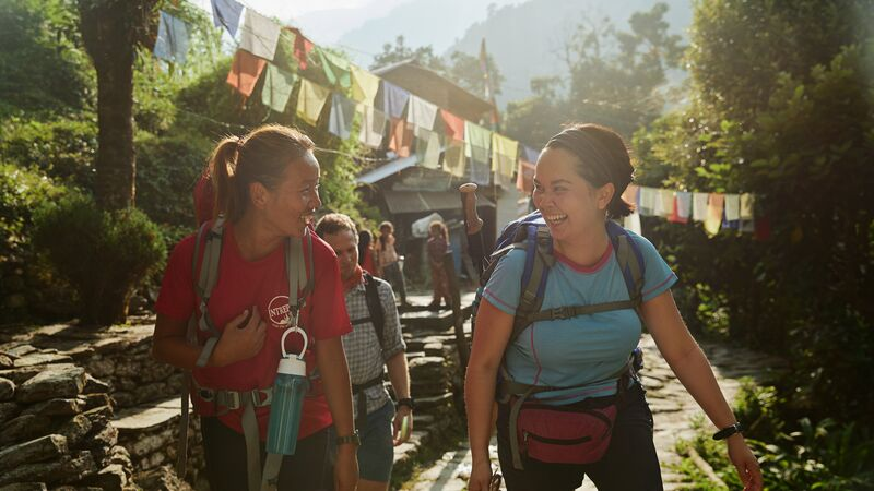 A trekker with her tour leader in Nepal