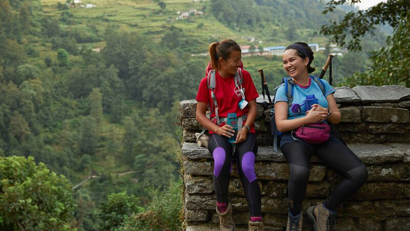 A leader and trekker on a trek in Nepal