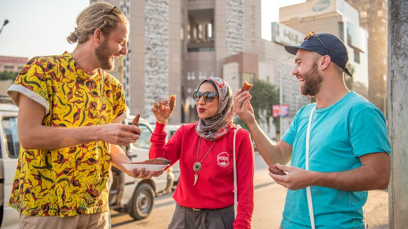 Two travellers with their tour leader in Egypt
