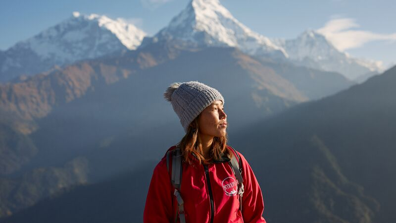 Nepalese leader in the mountains looking into the distance