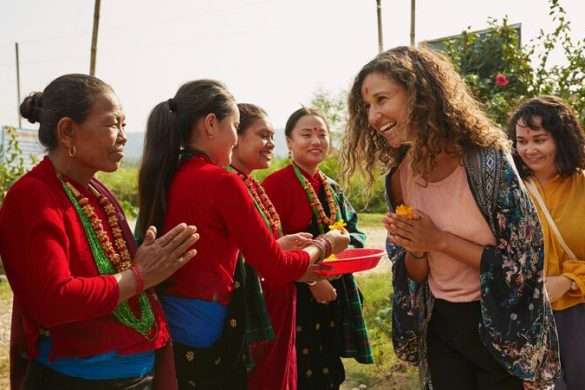Traveller with locals in Madi Valley Nepal