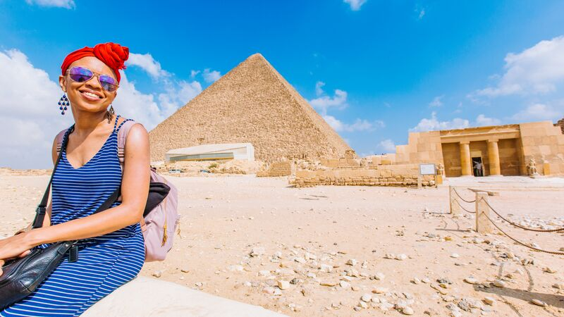 Traveller in front of the Pyramids