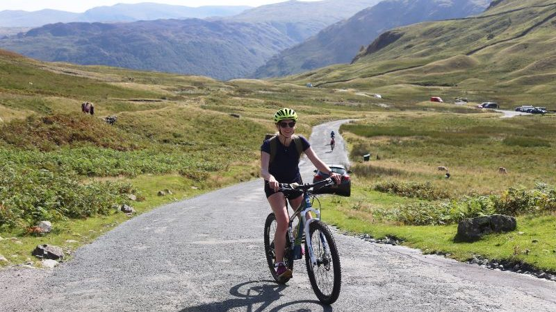 The author riding a bike in the Lake District