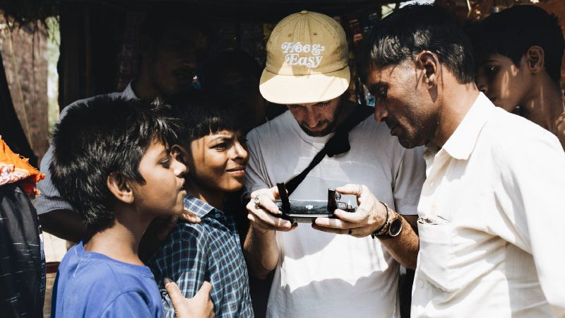Ben showing his drone to locals in India.