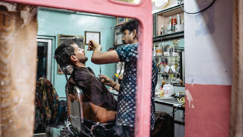 Getting a shave in India