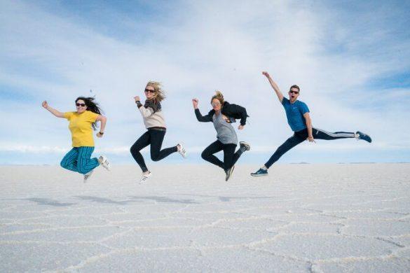 Travellers jumping in salar-de-uyuni-salt-flats
