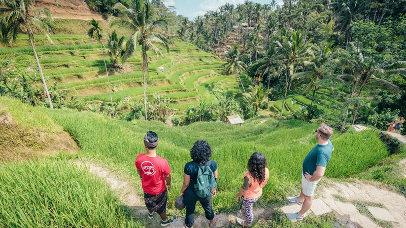 Travellers and leader in Bali