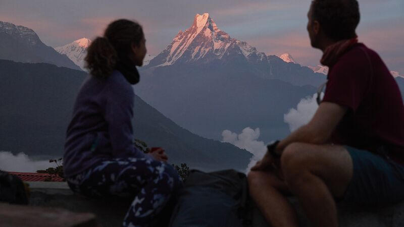 Travellers looking at Everest in Nepal