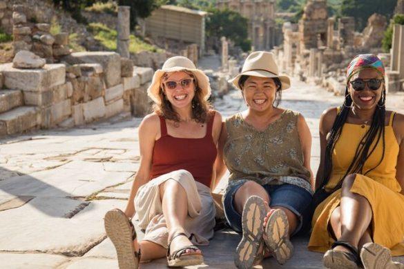 Travellers sitting in Ephesus, Turkey