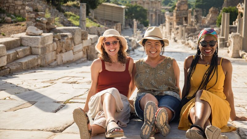 Travellers sitting in Ephesus, Turkey