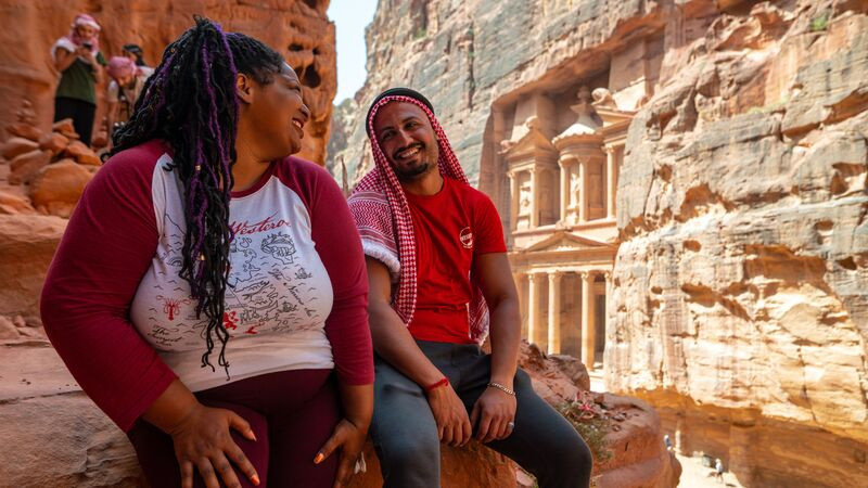 Traveller and leader laughing at Petra