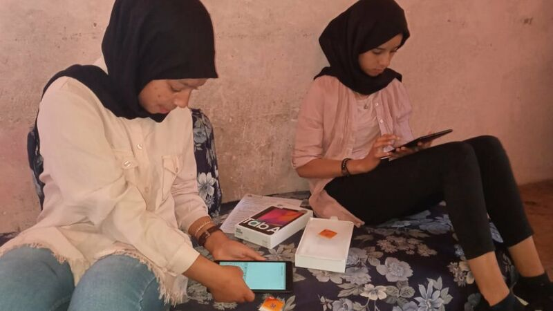 Young Moroccan women getting tablets