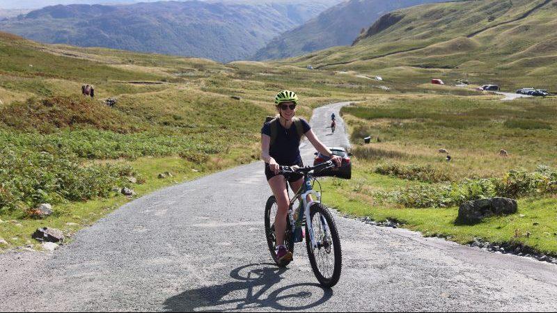 Female traveller on bike