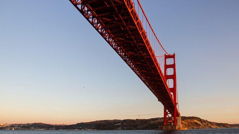 Under the Golden Gate Bridge at sunset.