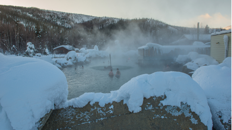 People bathing in Chena Hot Spring