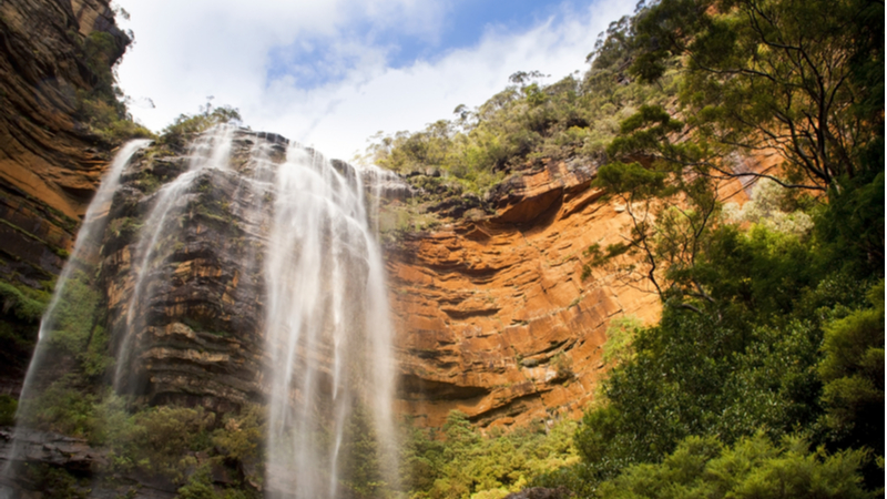 The three-tiered Wentworth Falls cascading down the rockface in the Blue Mountains, New South Wales.