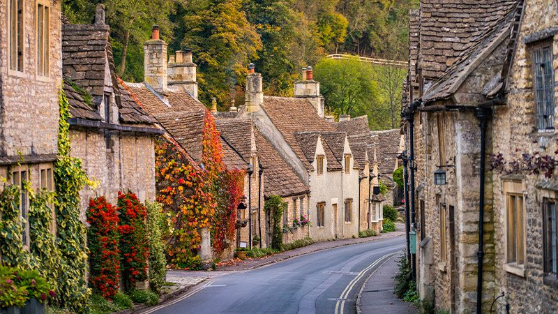 An idyllic street in a village in the Cotswolds.
