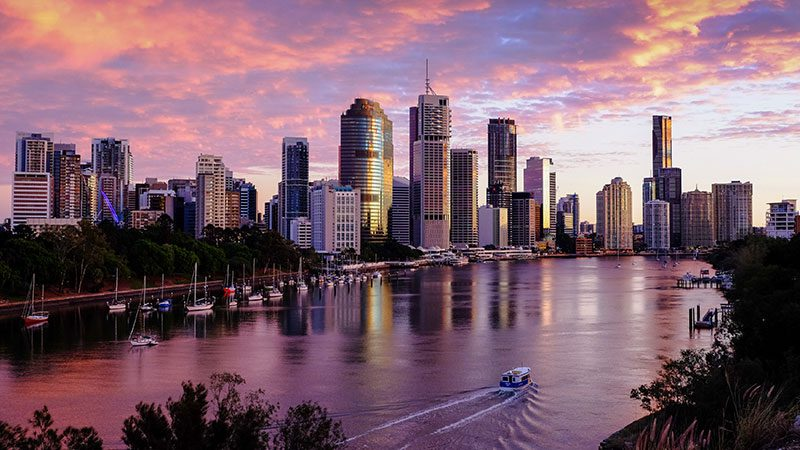 A beautiful pink and purple sunset over the city observed from Kangaroo Point in Brisbane.