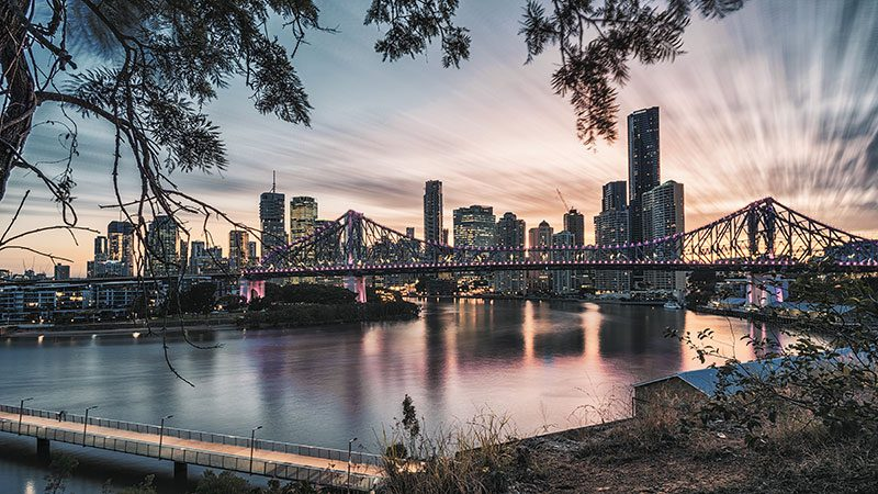 A view of the setting sun against the city from Wilson Outlook in Brisbane.