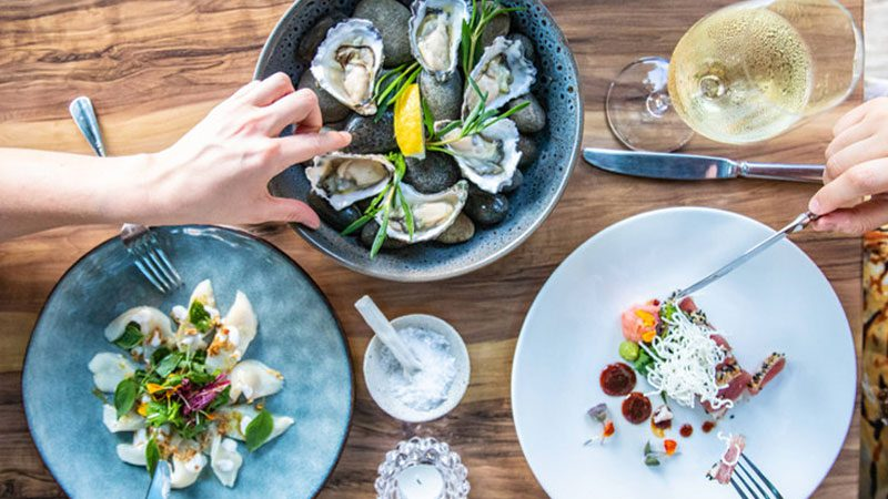 A birds eye shot of a selection of seafood from Melaleuca, a restaurant in Port Douglas.