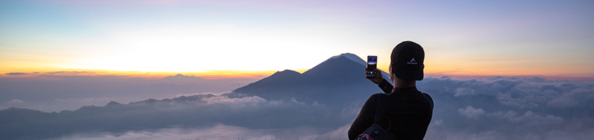 Taking photos of the sunrise on Mt Batur, Bali.