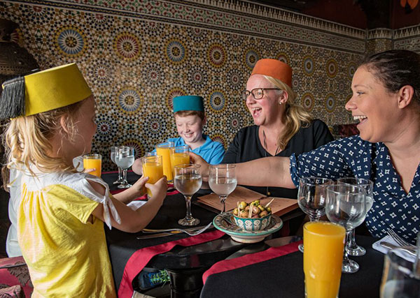 Travellers enjoying a fresh orange juice in Morocco