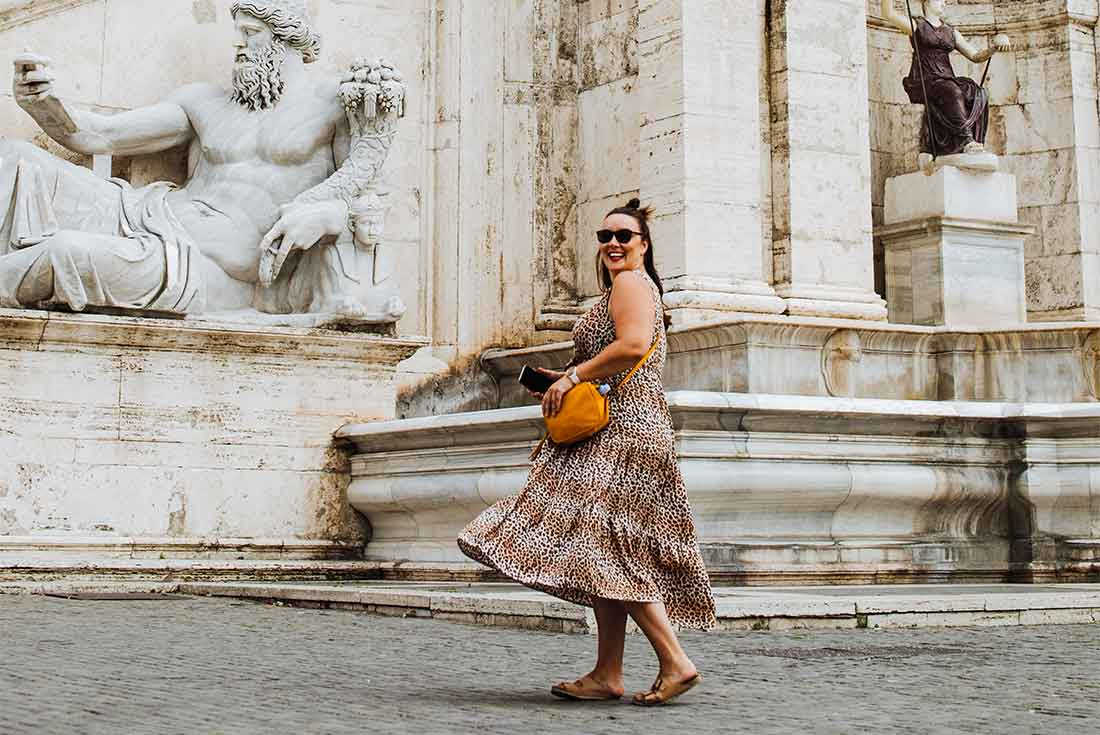 Girl wears long dress in Rome