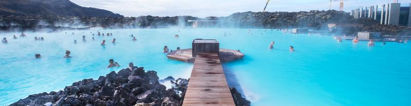 Travellers swimming in Iceland's iconic Blue Lagoon