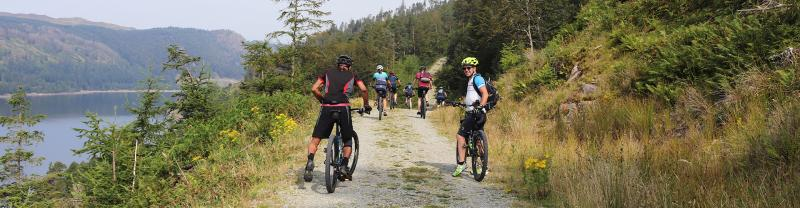 Group cycling in Thirlmere in the Lake District of England