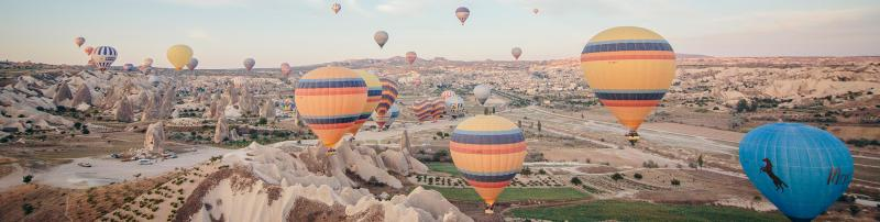 Balloons flying over Cappadocia, Turkey, as the sun rises